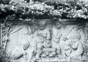 Photo: This cherub relief panel was one of 20 installed at the post office at Calvert and Fayette. The building was demolished in 1930, and one of those panels was relocated just west of the Madison Avenue Gateway in 1933.