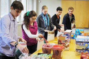 Students in Park's Philanthropy Club pack care packages to be sent to Park Alums at college.