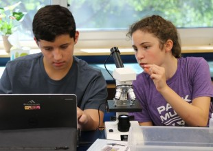 Photo: In Middle School science class, students are encouraged to think, explore, and behave like scientists. Science is an ongoing, evolving discipline, not simply a body of facts, and the more students are able to participate in the scientific process, the more keenly they come to understand this.