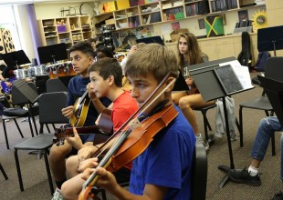 Photo: The overall goals of the Middle School music program are to help students become more knowledgeable about the world of music and to become more skilled performers and listeners.