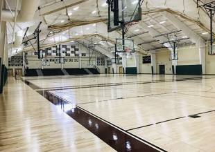 Photo: Park has 5 athletic courts, 3 side by side in the Athletic Center and 2 in an adjacent building. In addition, the Athletic Center lobby, small concession area, and a large conference room are available for use with multi-court rentals. The side by side courts can be separated by a remote controlled curtain or can be raised to combine the three spaces.