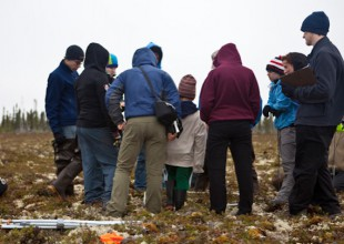 Photo: Researchers in the Arctic. Photo by K. Whitney