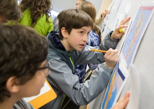 Photo: The 7th Grade curriculum covers valuable perspectives on private, public, personal, and community identities. Students confront important questions including how literature reveals who we are and others' points of view, and what the study of American history reveals about who we are as Americans.