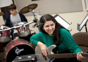 Photo: A student rock band practices in the Middle School Music Room.